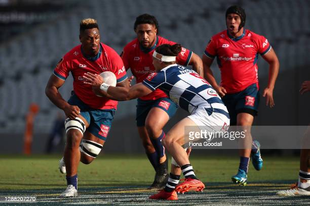 Te Ahiwaru Cirikidaveta of Tasman is defended by Jonathan Ruru of Auckland during the Mitre 10 Cup Final between Auckland and Tasman at Eden Park on...