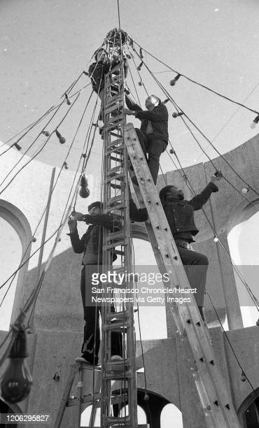 Te crew of the U.S. Navy ship Coral Sea, help put Christmas lights up at Coit Tower, December 18, 1975
