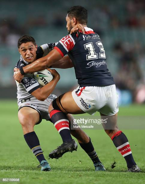 Te Maire Martin of the Cowboys is tackled by Isaac Liu of the Roosters during the NRL Preliminary Final match between the Sydney Roosters and the...