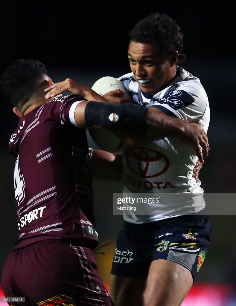 Te Maire Martin of the Cowboys is tackled during the round 13 NRL match between the Manly Sea Eagles and the North Queensland Cowboys at Lottoland on May 31, 2018 in Sydney, Australia.