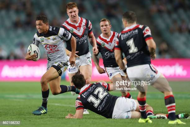 Te Maire Martin of the Cowboys makes a break to score a try during the NRL Preliminary Final match between the Sydney Roosters and the North...