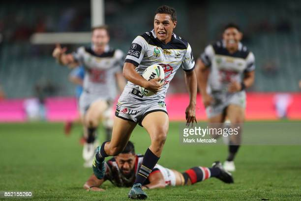 Te Maire Martin of the Cowboys scores a try during the NRL Preliminary Final match between the Sydney Roosters and the North Queensland Cowboys at...