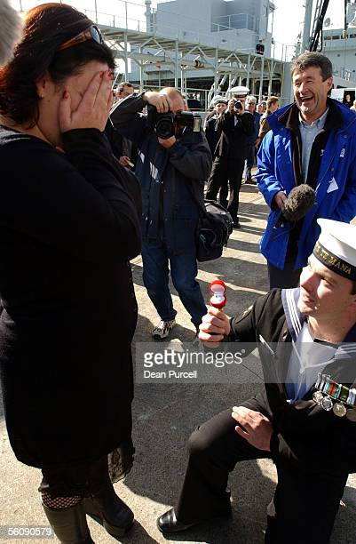 Te Mana crew member Steven Nind gets down on one knee to propose to his partner Kelly Taylor after he arrived back to Devonport Naval Base Monday The...