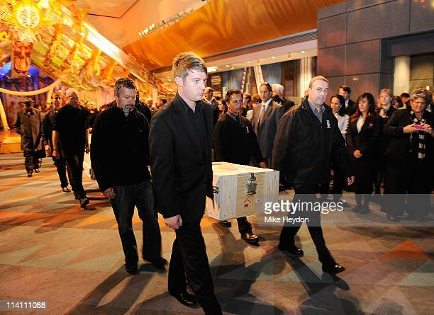 Te Papa staff carry boxes containing mummified Maori heads from Te Papa Museum on May 12 2011 in Wellington New Zealand One of the heads believed to...