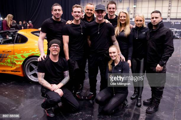 Te stunt drivers for the show pose backstage during the 'Fast Furious Live' technical rehearsal at NEC Arena on December 18 2017 in Birmingham England