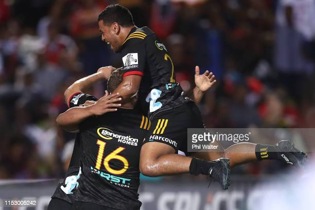 Te Toiroa Tahuriorangi of the Chiefs celebrates a try to Tumua Manu during the round 16 Super Rugby match between the Chiefs and the Crusaders at the...