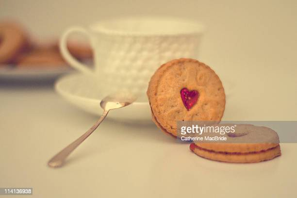 tea and biscuits with spoon - catherine macbride stock pictures, royalty-free photos & images
