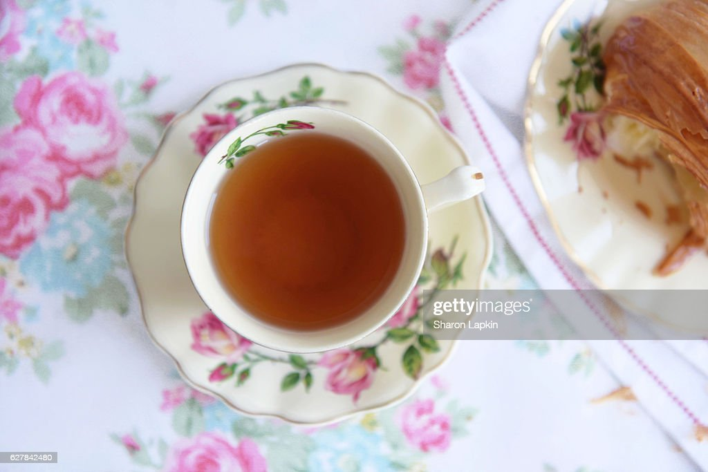Tea and croissant for breakfast : Stock Photo