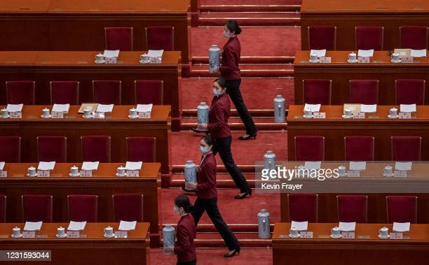Tea attendants practice before the second plenary session of the National People's Congress at the Great Hall of the People on March 8, 2021 in...