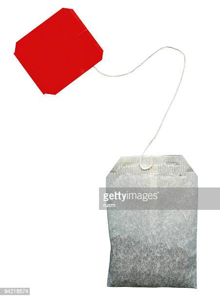 tea bag isolated with clipping path on white background - black tea stock pictures, royalty-free photos & images