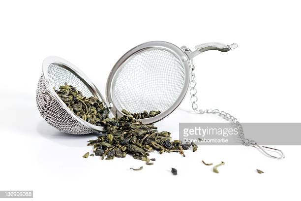 tea ball - tea leaves stock photos and pictures