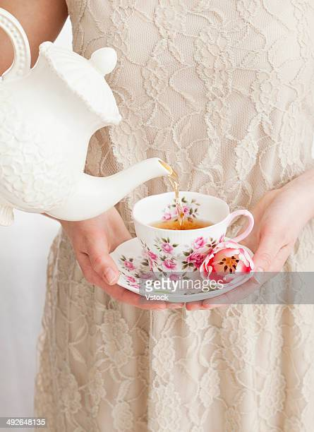 Tea being poured into girl's (2-13) cup