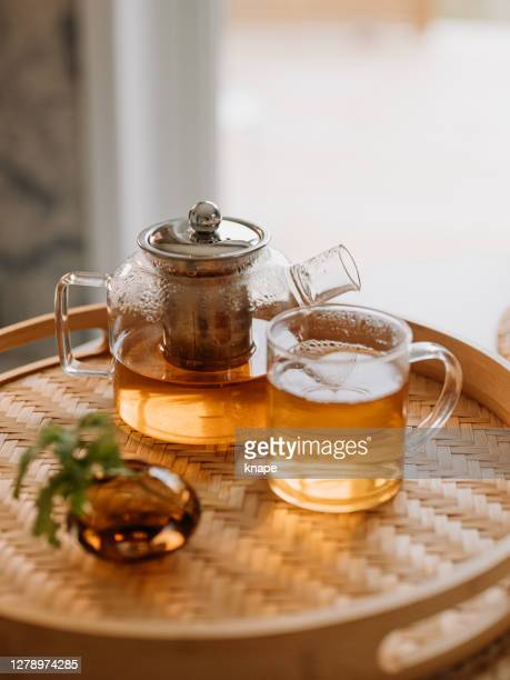 tea ceremony fresh brewed tea in glas cup and teapot - ceremony stock pictures, royalty-free photos & images