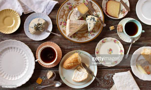 tea & cheese party over-head rustic table vintage plates - ふぞろい ストックフォトと画像