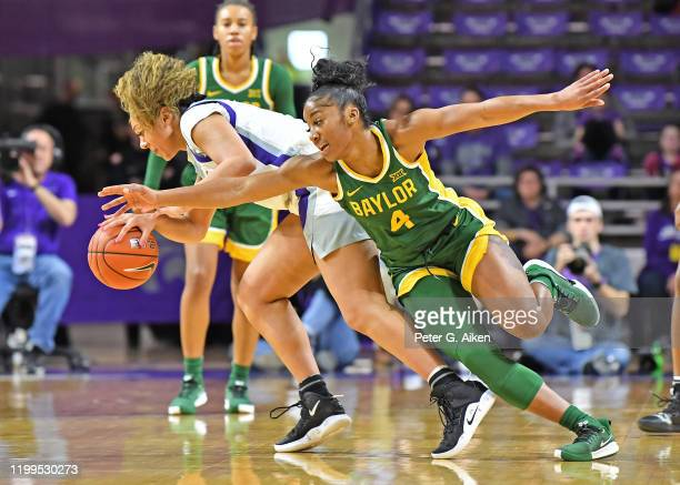 Te'a Cooper of the Baylor Lady Bears reaches in for the ball against Savannah Simmons of the Kansas State Wildcats during the first quarter on...