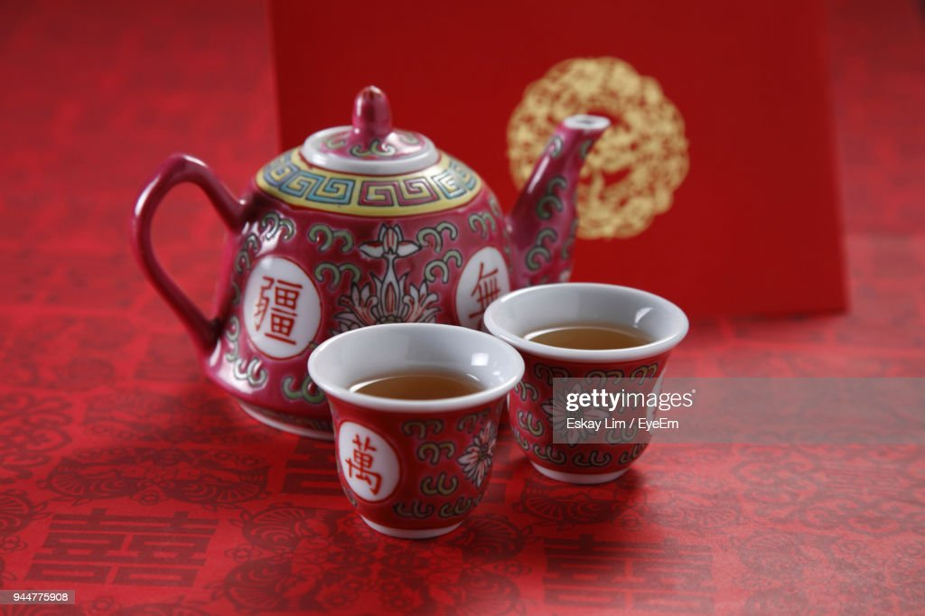 Tea Cups With Pot On Table : Stock Photo