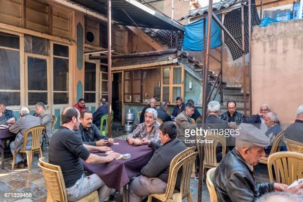 Tea house, men playing domino, or okey game, Antakya, Hatay, southeastern Turkey 'n
