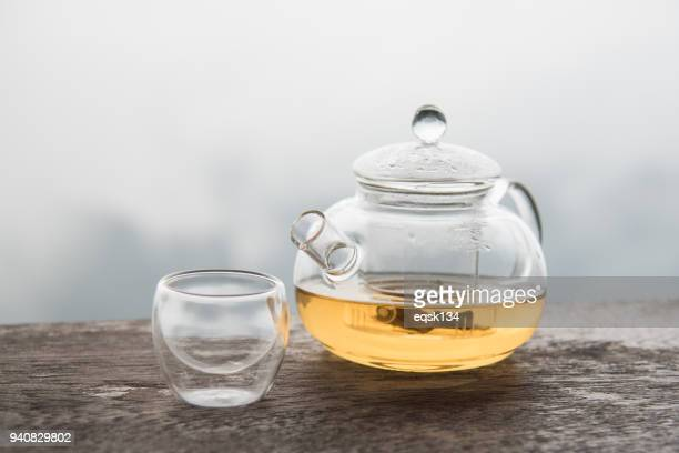 tea in glass teapot with nature view - ティーポット ストックフォトと画像