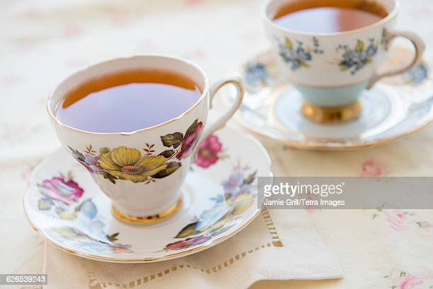 tea in tea cup on table - saucer stock pictures, royalty-free photos & images