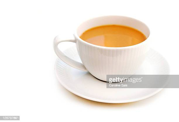 tea in tea cup - saucer stock pictures, royalty-free photos & images