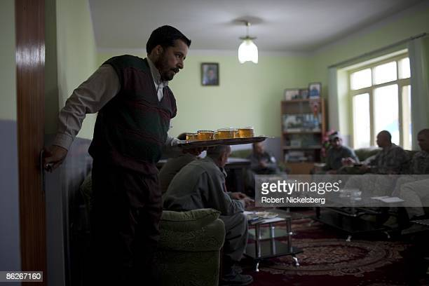 Tea is delivered during a meeting April 11 2009 with senior Afghan National Police officers center left and US Army LTC Kimo Gallahue right a...