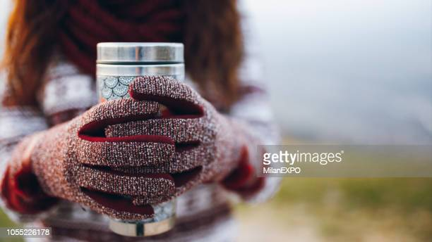 tea keeps me warm outside - flask stock pictures, royalty-free photos & images