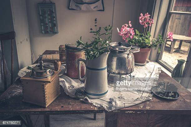 Tea Kettle And Flower Vases On Table At Home