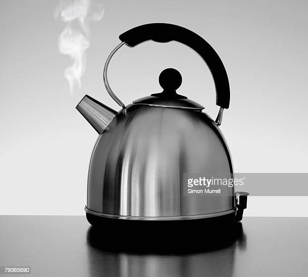 tea kettle with steam indoors - boiled stock pictures, royalty-free photos & images