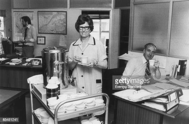 Tea lady Alice Bond providing refreshments for office workers 13th July 1976