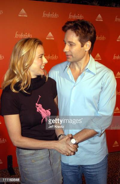 Tea Leoni and David Duchovny during Frederick's of Hollywood Debuts Fall 2003 Collection at Smashbox Studios in Culver City CA United States