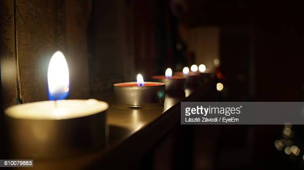 Tea Light Candles Burning In Room