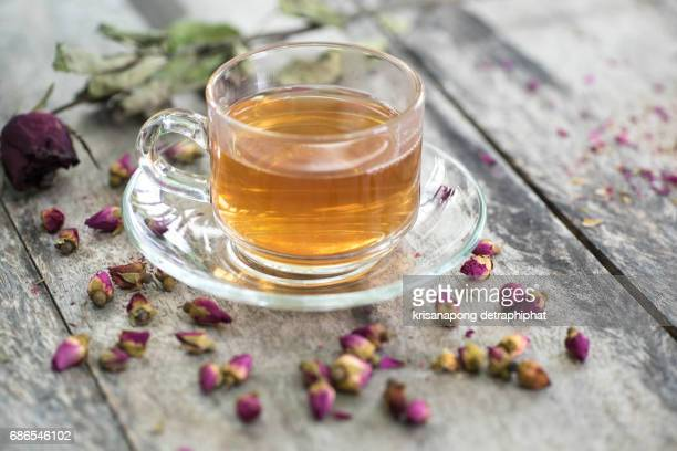 tea made from tea rose petals in a glass bowl on wooden  background - detox stock pictures, royalty-free photos & images