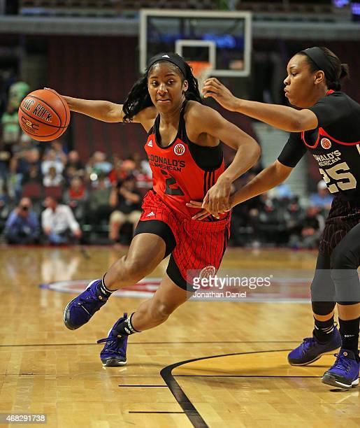 Te'a Omari Cooper of the West team drives against Asia Durr of the East team during the 2015 McDonalds's All American Game at the United Center on...