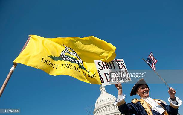 Tea party activist John Oltesvig of North Carolina wears a colonial costume with a tricorner hats as he participates in the rally at the Capitol on...