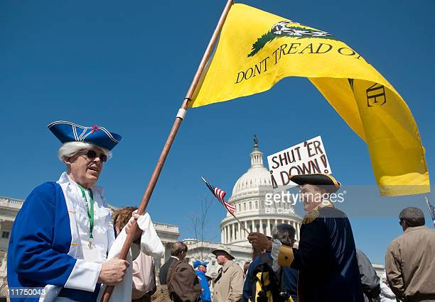 Tea party activists Bob Mason left and John Oltesvig both of North Carolina wear colonial costumes with tricorner hats as they participate in the...