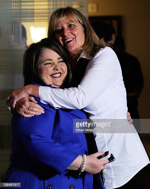 Tea Party Express Chairwoman Amy Kremer hugs President of America's Mighty Warriors Debbie Lee as they watch Kentucky Republican Senate candidate...