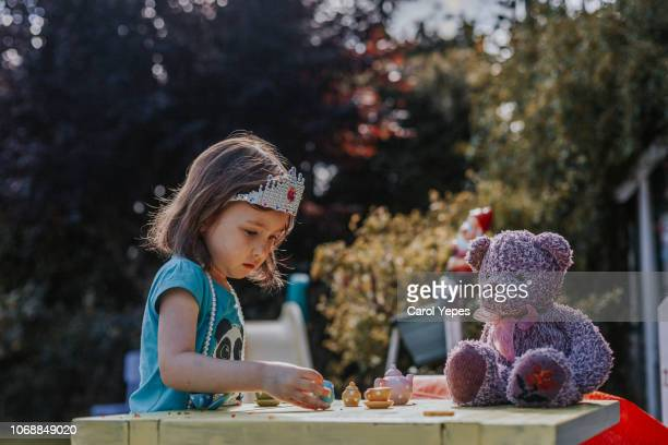 tea party girl - tea party stock pictures, royalty-free photos & images