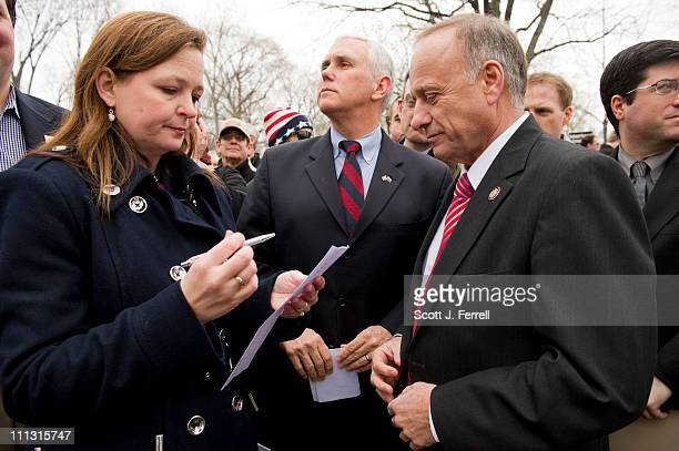 Tea Party National Coordinator Jenny Beth Martin talks with Rep Mike Pence RInd and Rep Steve King RIowa before the members spoke during a Tea Party...