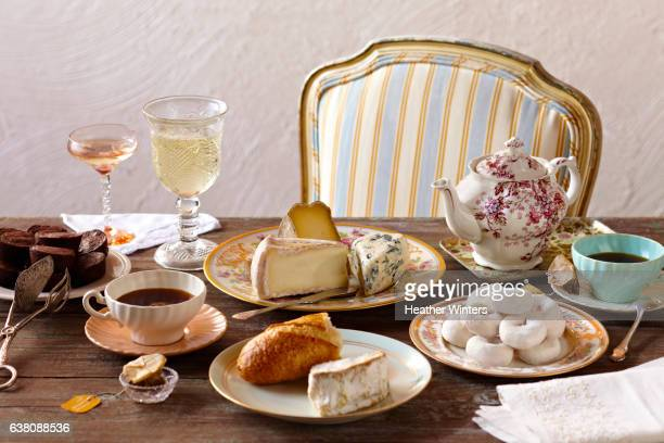 Tea Party on Rustic Table with Vintage tableware