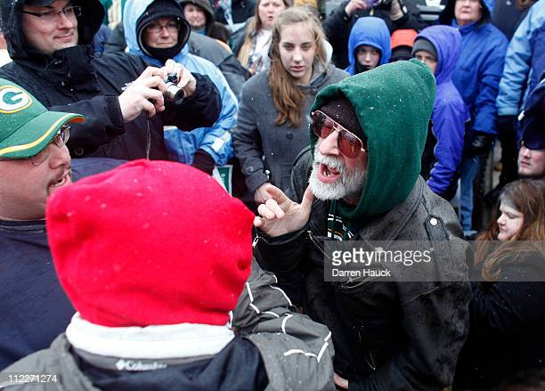 Tea Party supporter argues with a Tea Party critic before a rally held by Americans for Prosperity at which Alaska Gov Sarah Palin was to speak at...
