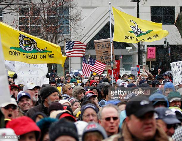 Tea Party supporters and protestors gather at a rally held by Americans for Prosperity to see former Alaska Gov Sarah Palin speak at the Wisconsin...