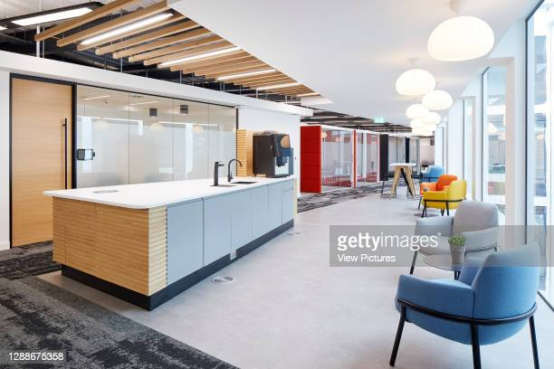 Tea point area . Contemporary UK office interior with primary colour furniture. UK Office, London, United Kingdom. Architect: IOR, 2019.