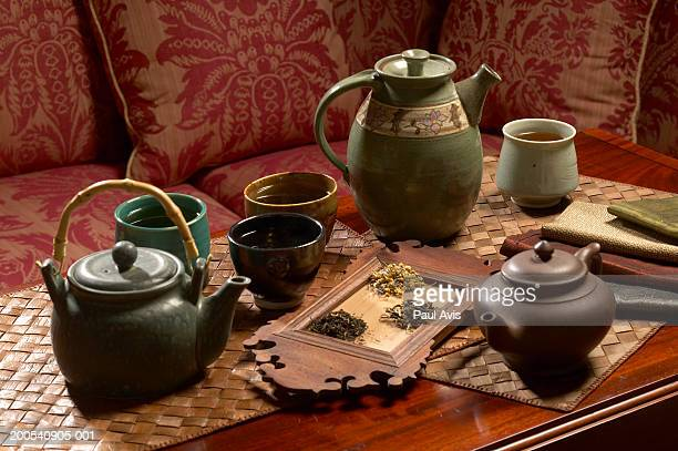 Tea pot and cups, assortment of tea, close-up