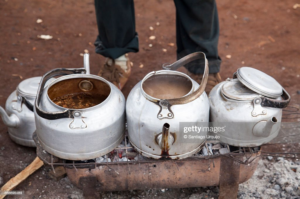 Tea pots on a coal grill : Stock Photo
