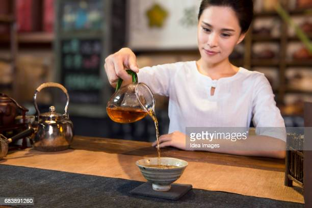 Tea room owner serving tea