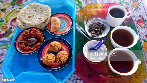 Tea set and snacks served in Sri Lanka