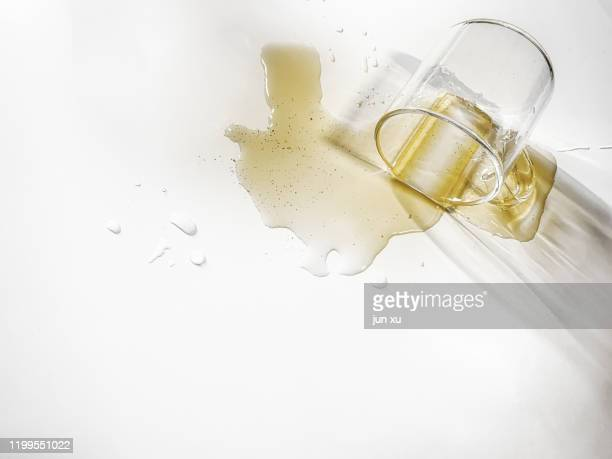 tea stains on a glass on a white background - wine stain stockfoto's en -beelden