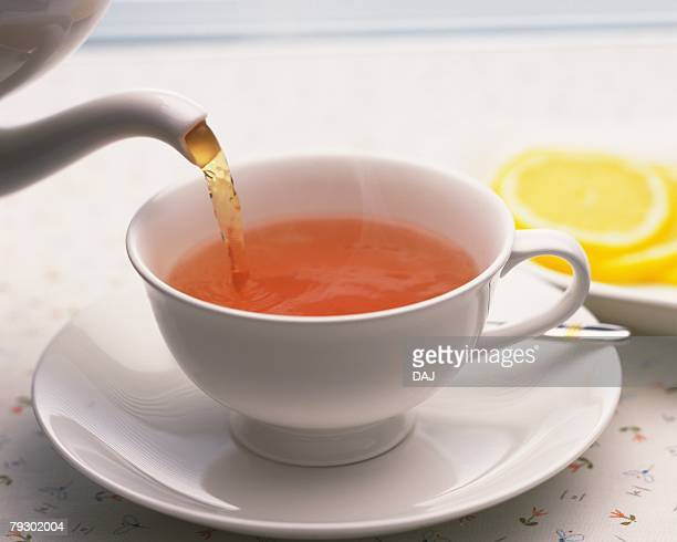 Tea That is Poured in the Cup and Lemon Slice, Full Frame