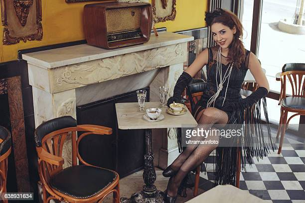 Tea time  Old fashioned young women  drinking tea  Retro party