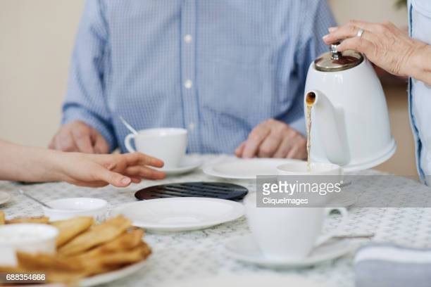 tea time with family - cliqueimages stock pictures, royalty-free photos & images